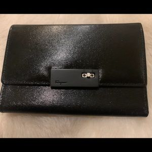 Salvatore Ferragamo black leather trifold wallet